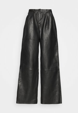 PINE PANTS - Leather trousers - black