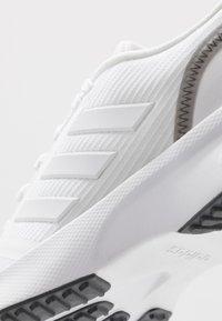 adidas Performance - NOVA FLOW - Zapatillas de running neutras - footwear white/grey six - 5