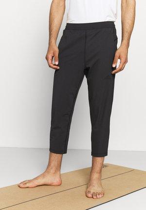 7/8 DESIGNED4TRAINING AEROREADY - Teplákové kalhoty - black