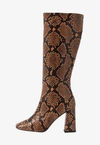 High heeled boots - camel