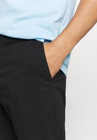 Tommy Hilfiger Tailored - FLEX SLIM FIT PANT - Chinos - black - 4