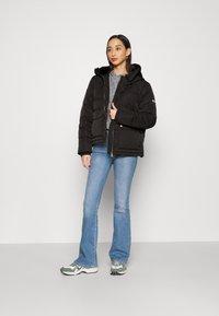 Tommy Jeans - HOODED JACKET - Winter jacket - black - 1