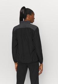 Puma - TEAMGOAL SIDELINE JACKET - Training jacket - black - 2