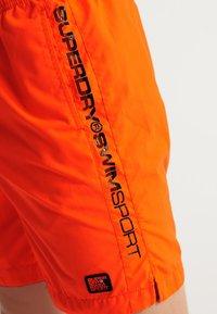 Superdry - SUPERDRY SWIMSPORT SHORTS - Swimming shorts - bright havana orange - 3