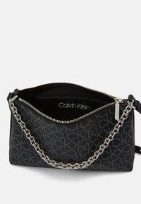 Calvin Klein - CROSSBODY CHAIN - Handbag - black - 2