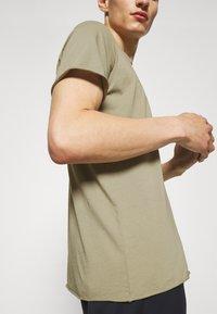 Filippa K - ROLL NECK TEE - Basic T-shirt - sage green - 6