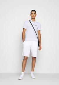EA7 Emporio Armani - Polo shirt - white - 1