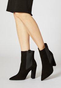 faina - High heeled ankle boots - black - 0
