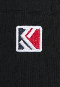 Karl Kani - SIGNATURE  - Tracksuit bottoms - black - 5