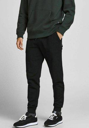 GORDON - Tracksuit bottoms - black
