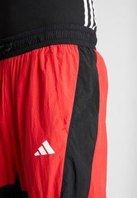 adidas Performance - SHAPE PANT - Tracksuit bottoms - scarlet - 3