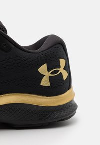 Under Armour - CHARGED BANDIT  - Zapatillas de running neutras - black - 5