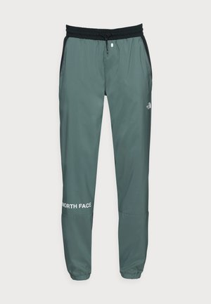 WIND PANT - Tracksuit bottoms - balsam green