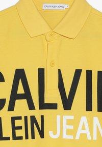 Calvin Klein Jeans - STAMP LOGO  - Polo shirt - yellow - 3