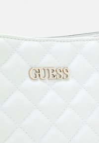 Guess - ILLY BUCKET - Across body bag - white - 2
