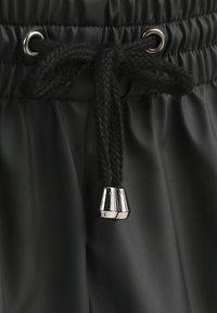 Rains - UNISEX TROUSERS - Teplákové kalhoty - black - 2