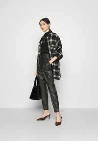 Vero Moda - VMEVA PAPERBAG ANKLE PANTS - Trousers - black - 1