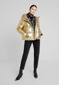 Calvin Klein Jeans - PUFFER JACKET - Vinterjakke - gold - 1