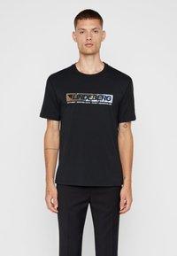 J.LINDEBERG - JORDAN - Print T-shirt - black - 0
