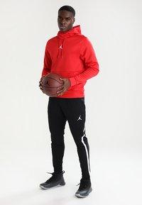 Jordan - ALPHA DRY PANT - Jogginghose - black/white - 1