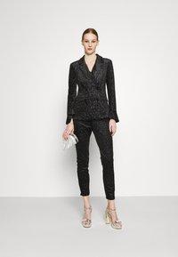 Never Fully Dressed - GLITTER DYNASTY TROUSER - Kalhoty - black - 1