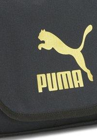 Puma - Across body bag - puma black-gold - 2