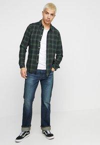 Levi's® - 527™ SLIM BOOT CUT - Jeans Bootcut - durian super tint overt - 1