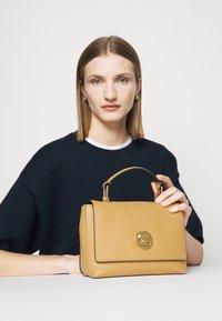 Coccinelle - LIYA - Handbag - warm beige/noir - 1