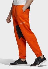 adidas Originals - ADVENTURE FIELD JOGGERS - Tracksuit bottoms - orange - 2