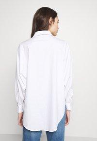 Vero Moda Petite - VMMIE SHIRT PETIT - Button-down blouse - bright white - 2