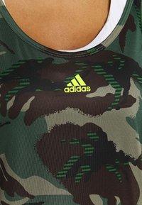 adidas Performance - CAMO - T-shirt de sport - green oxide/acid yellow - 4