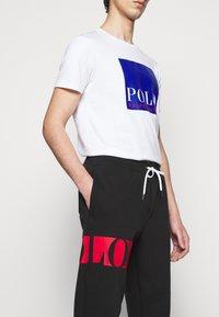 Polo Ralph Lauren - DOUBLE TECH - Pantaloni sportivi - black - 3