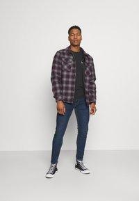 Levi's® - 519™ EXT SKINNY HI BALLB - Jeans Skinny Fit - goth he bad od adv - 1