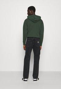Carhartt WIP - PONTIAC PANT MAITLAND - Straight leg jeans - black stone washed - 3