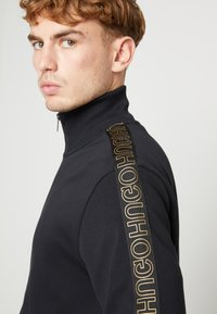 HUGO - DASAYO - Sweatjacke - black/gold - 5