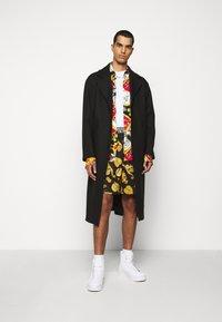 Versace Jeans Couture - DIAGONAL COAT MIRO - Cappotto classico - nero - 0