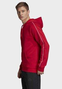 adidas Performance - CORE 19 HOODIE - Huvtröja med dragkedja - red - 3