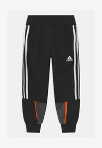 adidas Performance - BOLD UNISEX - Tracksuit bottoms - black/dark grey - 0