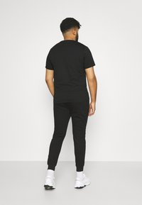 Johnny Bigg - TROY CUFF TRACKPANT - Tracksuit bottoms - black - 2