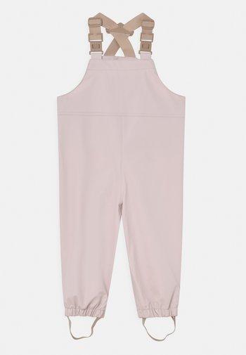 RUBI UNISEX - Rain trousers - mauve chalk