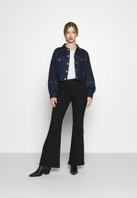 Levi's® - TAILORED TRUCKER - Veste en jean - allow me