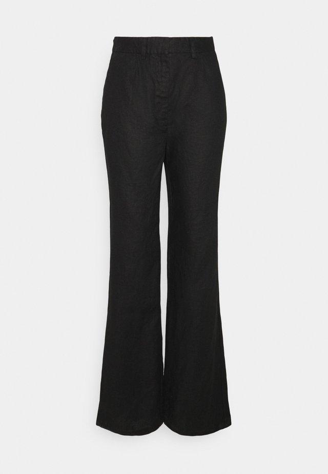 FLARED PANTS - Stoffhose - black