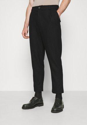 SMOKE - Trousers - black