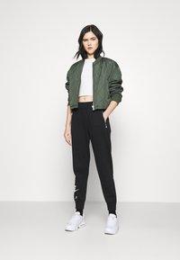 Nike Sportswear - AIR PANT   - Tracksuit bottoms - black/white - 1