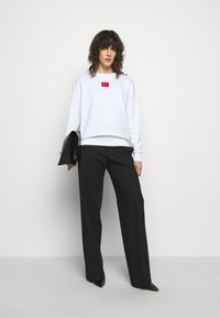 HUGO - NAKIRA - Sweatshirt - white - 1