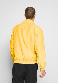 Nike Performance - NBA LOS ANGELES LAKERS CITY EDITION JACKET - Club wear - amarillo/white - 2