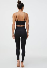 OYSHO - Light support sports bra - black - 2