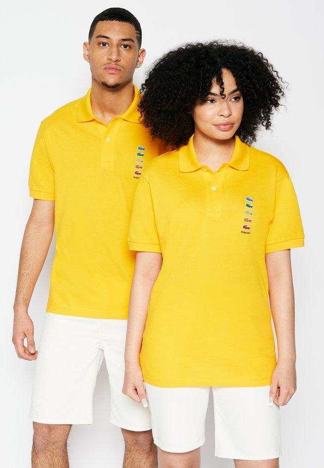 POLAROID UNISEX - Polo shirt - gypsum