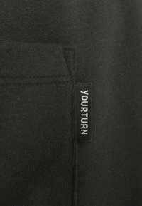 YOURTURN - LOOSE FIT JOGGERS UNISEX - Tracksuit bottoms - black - 2