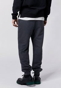 Tigha - COSMO - Tracksuit bottoms - vintage black - 2